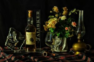 Tartan table spread with Islay Whisky gifts and flowers